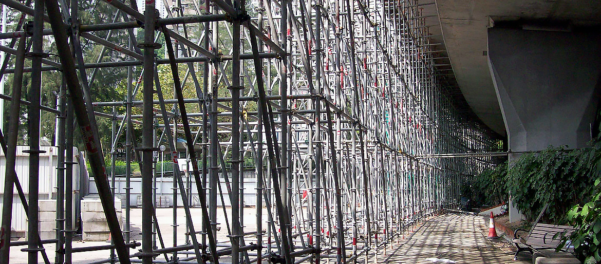 Ringlock system at work – Full usage of horizontal, vertical, diagonal braces plus support jacks to form support for retrofitting of noise barrier on Tseung Kwan O Road, Kwun Tong.